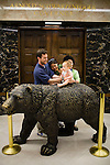 Nine-month-old Senna Park-Delury of Brooklyn is propped up on the bear statue in front of Governor Arnold Schwarzenegger's office in the State Capitol in Sacramento, California.