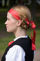 Close-up of Young Woman in Estonian National Costume Wearing Headband