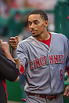 20 May 2014: Cincinnati Reds outfielder Billy Hamilton gets a fist bump in the dugout during a game against the Washington Nationals at Nationals Park in Washington, DC. The Nationals defeated the Reds 9-4 to take the second game of their 3-game series. Mandatory Credit: Ed Wolfstein Photo *** RAW (NEF) Image File Available ***