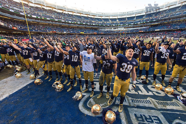 Dec. 28, 2013; The Irish sing the Alma Mater after winning the Pinstripe Bowl in Yankee Stadium.<br /> <br /> Photo by Matt Cashore