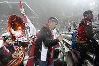 Under a heavy snowfall, USA fans play instruments while leaving Dick's Sporting Good Park in Commerce City, CO  after the USA Men's National Team's World Cup Qualifier victory against Costa Rica on March 22, 2013.