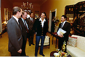United States President Ronald reagan welcomes visitors to the White House Residence on Monday, April 13, 1981 as he recovers from the March 31,1981 assassination attempt.  From left to right: James A. Baker, III; Edwin Meese; Vice President George H.W. Bush; President Reagan; and U.S. Secretary of Defense Caspar Weinberger..Mandatory Credit: Michael Evans - White House via CNP
