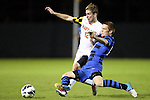 12 October 2012: Maryland's Jereme Raley (12) and Duke's Ryan Thompson (right). The University of Maryland Terrapins defeated the Duke University Blue Devils 2-1 at Koskinen Stadium in Durham, North Carolina in a 2012 NCAA Division I Men's Soccer game.