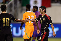 Mexico midfielder Angel Reyna (8) celebrates with midfielder Giovani Dos Santos (10). Mexico defeated the Ivory Coast 4-1 during an international friendly at MetLife Stadium in East Rutherford, NJ, on August 14, 2013.
