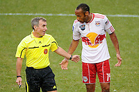 Thierry Henry (14) of the New York Red Bulls talks with referee Michael Kennedy. The New York Red Bulls defeated Manchester City F. C.2-1 during a Barclays New York Challenge match at Red Bull Arena in Harrison, NJ, on July 25, 2010.