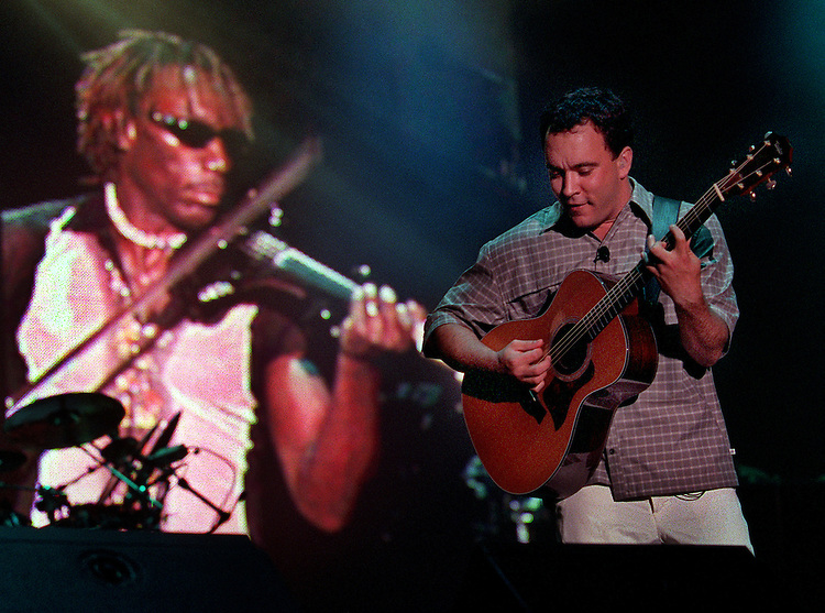 With violinist Boyd Tinsley projected on a big screen at left,  Dave Matthews rocks the crowd at Dodger Stadium, Tuesday night in Los Angeles.