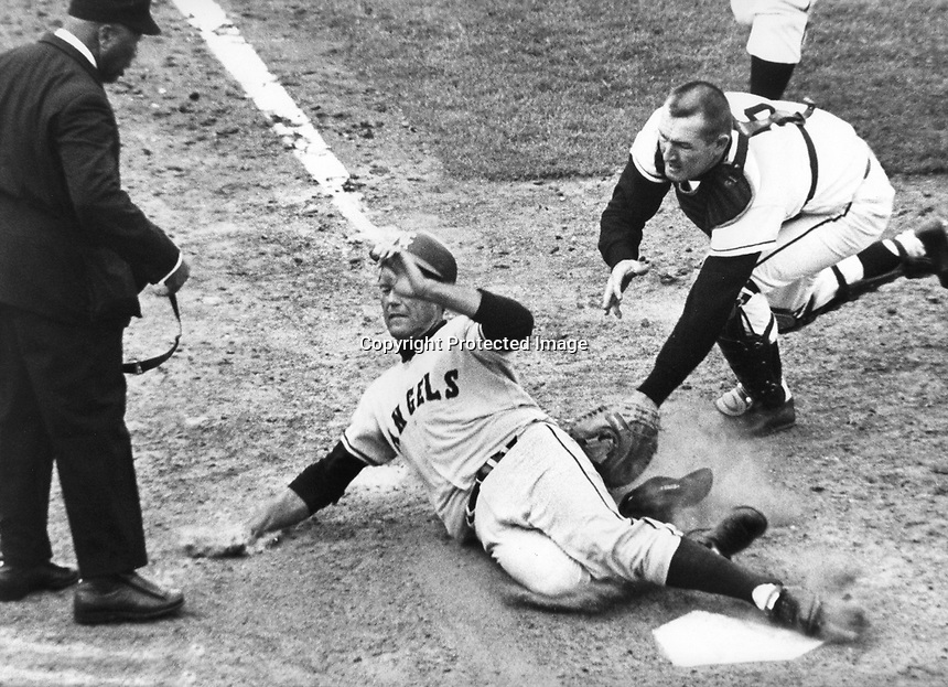 san Francisco Giants catcher Tom Haller tags Angels runner at home.Umpire is Emmett Ashford. (April 8,1967 photo/Ron Riesterer)