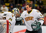 2 December 2011: University of Vermont Catamount goaltender John Vazzano (right), a Senior from Trumbull, CT, gives his roomate Rob Madore (left), a Senior goaltender from Pittsburgh, PA, a good luck tap prior to a game against the University of Maine Black Bears at Gutterson Fieldhouse in Burlington, Vermont. The Catamounts fell to the Black Bears 6-4 in the first game of their 2-game Hockey East weekend series. Mandatory Credit: Ed Wolfstein Photo