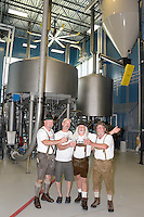 Brewmasters Pat Keller (Great Dane, Fitchburg), Tom Porter (Lake Louie), Kirby Nelson and Mike McGuire (Wisconsin Brewing; L-R) toast the creation of Wisconsin Brewing Company's Depth Charge Scotch Ale on Sunday in Verona, Wisconsin