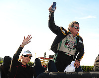 Nov 14, 2010; Pomona, CA, USA; NHRA funny car driver John Force (right) celebrates with daughter Ashley Force Hood after clinching the 2010 funny car championship during the Auto Club Finals at Auto Club Raceway at Pomona. Mandatory Credit: Mark J. Rebilas-