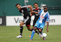 WASHINGTON, D.C. - AUGUST 19, 2012:  Dwayne DeRosario (7) of DC United loses the ball to Michael Lahoud (13) of the Philadelphia Union during an MLS match at RFK Stadium, in Washington DC, on August 19. The game ended in a 1-1 tie.