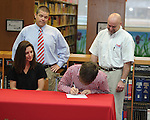 Lafayette High's Tyler Jackson (87) signs a National Letter of Intent to play football at Itawamba Community College in Oxford, Miss. on Wednesday, February 1, 2012.