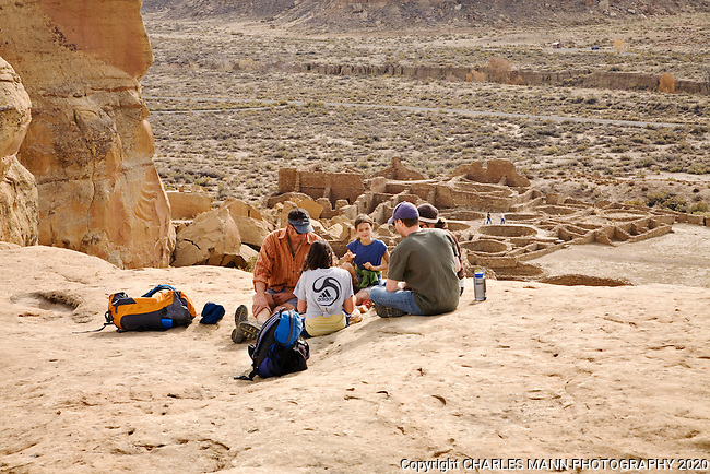 A family of visitors  stops for a picnic lunch at the Pueblo Bonito overlook on the Alto Mesa Rim Trail at Chaco Culture National Historical Park.