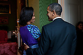 United States President Barack Obama and First Lady Michelle Obama talk in the Green Room of the White House before hosting a Smithsonian Museum of African American History reception in the East Room, February 22, 2012. .Mandatory Credit: Pete Souza - White House via CNP