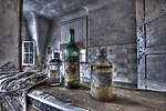 Abandoned lunatic asylum north of Berlin, Germany. Old bottles on shelf.