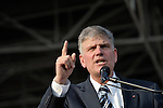 Just before the one-year anniversary of the January 2010 earthquake that ravaged Port-au-Prince, Haiti, Franklin Graham, the conservative U.S. evangelical leader, preached to a rally at the national soccer stadium.