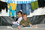 Two children play with stones in the Zaatari Refugee Camp, located near Mafraq, Jordan. Opened in July, 2012, the camp holds upwards of 50,000 refugees from the civil war inside Syria, but its numbers are growing. International Orthodox Christian Charities and other members of the ACT Alliance are active in the camp providing essential items and services.