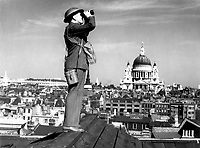 Aircraft spotter on the roof of a building in London with St. Paul's Cathedral in the background.  New York Times Paris Bureau Collection.  (USIA)<br /> Exact Date Shot Unknown<br /> NARA FILE #:  306-NT-901B-3<br /> WAR &amp; CONFLICT BOOK #:  1000