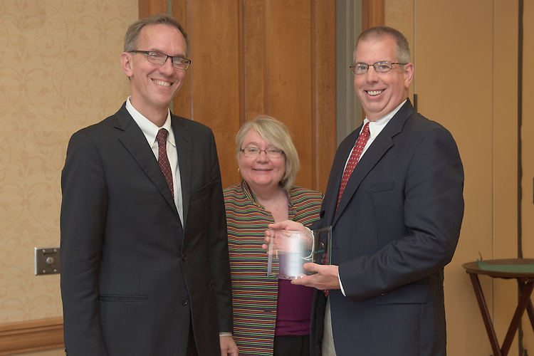 From left: Joseph Shields, Vice President for Research & Creative Activity and Dean of Ohio University's Graduate College along with Pam Benoit, Executive Vice President and Provost, name James Tomas as one of five Presidential Research Scholars during the 2016 Faculty Awards Recognition Ceremony held at Baker Center on Tuesday, September 6, 2016.