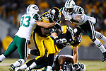 PITTSBURGH, PA - JANUARY 23: Rashard Mendenhall #34 of the Pittsburgh Steelers is tackled by Eric Smith #33 and Darrelle Revis #24 of the New York Jets in the AFC Championship Playoff Game at Heinz Field on January 23, 2011 in Pittsburgh, Pennsylvania(Photo by: Rob Tringali) *** Local Caption *** Rashard Mendenhall;Eric Smith;Darrelle Revis