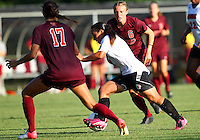 WINSTON-SALEM, NORTH CAROLINA - August 30, 2013:<br />  Charlyn Corral (9) of Louisville University breaks between Taylor Antolino (17) and Jodie Zelenky (6) of Virginia Tech during a match at the Wake Forest Invitational tournament at Wake Forest University on August 30. The game ended in a 1-1 tie.