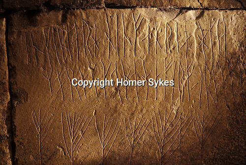 Runes, Maes Howe, Nr Stromnes, Orkney. Scotland. UK. Runic writing inside Maes Howe burial chamber. Broken into cnturies ago by a Viking plundering party they left a series of twenty four Runic inscriptions - graffiti. Similar in contect to modern graffiti. Boasting of female conquest and theft by Hakon who 'single handed bore treasure from this howe'.