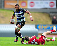Taulupe Faletau of Bath Rugby gets past Steffan Evans of the Scarlets. Pre-season friendly match, between the Scarlets and Bath Rugby on August 20, 2016 at Eirias Park in Colwyn Bay, Wales. Photo by: Patrick Khachfe / Onside Images
