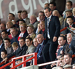 Scotland manager George Burley takes his seat in the directors box at the start of the second half after watching Derek Riordan fire his goal