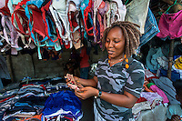BRAC micro-finance project. Esther Washington is selling used clothing in Red Light market, makes about $93 per month. Got BRAC loan.