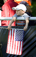 A young fan watches training in Hamburg, Germany, for the 2006 World Cup, June, 6, 2006.