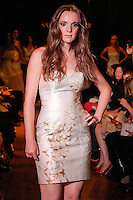 Model walks the runway in an Intrigue wedding dress - strapless hand painted silk satin cocktail dress with beading, by Sarah Jassir, for the Sarah Jassir Couture Bridal Fall 2012 Opulence collection.