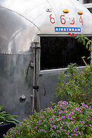 "Cape Town, South Africa, September 2011. Grand Daddy Hotel Airstream ""trailer park"". They hauled seven classic American Airstream trailers up onto the Penthouse level in Long Street, the most bo-ho address in town, and invited the city's top inerior designers to jazz them up, so there're all shiny aluminium on the outside and different inside. There's an African one, an Elvis one, John and Yoko, Dorothy and so on. They all have aircon, hot and cold running water, flush loos and showers and each has its own teeny private garden. Photo by Frits Meyst/Adventure4ever.com"