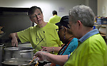 Harriett Olson, the top executive of United Methodist Women, helps prepare food at the Fourth Avenue United Methodist Church in Louisville, Kentucky, on April 24, 2014, the Ubuntu day of service before the United Methodist Women Assembly in Louisville, Kentucky. The church provides food to homeless and underemployed people.