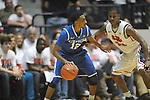 Kentucky's Ryan Harrow (12) vs. Ole Miss' Jarvis Summers (32) at the C.M. &quot;Tad&quot; Smith Coliseum on Tuesday, January 29, 2013. Kentucky won 87-74. (AP Photo/Oxford Eagle, Bruce Newman)..
