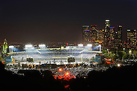 07/26/11 Los Angeles, CA: Night View of Dodger Stadium with Downtown Los Angeles in the background from atop Elysian Park during the Colorado Rockies Los Angeles Dodgers baseball game.