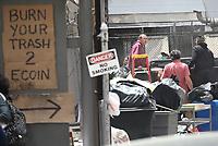 NEW YORK, NY - MAY 11: Rami Malek burning trash on set of Mr. Robot on May 11, 2017 in New York City. Credit: DC/Media Punch