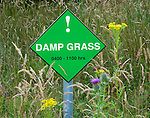 Damp grass warning sign
