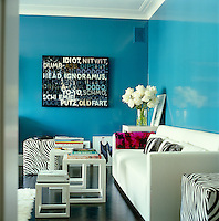 "In the master bedroom the walls have been lacquered a vivid turquoise to give the feeling of ""an Art Deco box"", the perfect foil for a Mel Bochner painting"