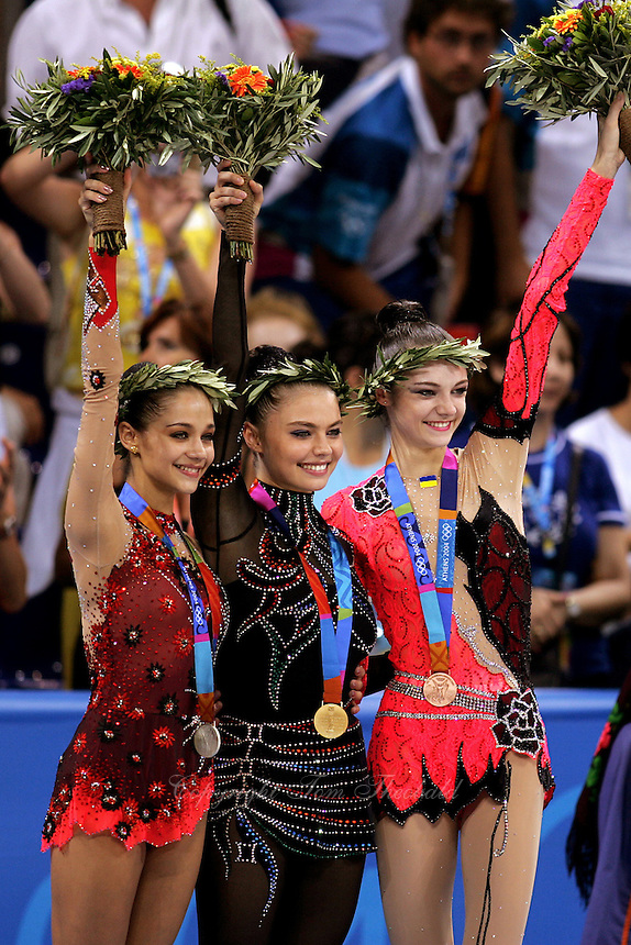 August 29, 2004; Athens, Greece; (L-R) Rhythmic gymnasts IRINA TCHACHINA of Russia, ALINA KABAEVA of Russia and ANNA BESSONOVA of Ukraine won silver, gold, bronze respectively in All-Around at 2004 Athens Olympics.<br />