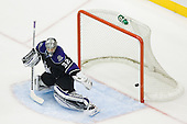 Puck hits the post on Jonathan Quick (Los Angeles Kings, #32) net during ice-hockey match between Los Angeles Kings and Detroit Red Wings in NHL league, February 28, 2011 at Staples Center, Los Angeles, USA. (Photo By Matic Klansek Velej / Sportida.com)