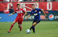 Manchester United midfielder Ryan Giggs (11) plays the ball with Chicago Fire midfielder Marco Pappa (16) in pursuit.  Manchester United defeated the Chicago Fire 3-1 at Soldier Field in Chicago, IL on July 23, 2011.