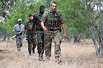Anti-poaching unit on patrol in the bush, l-r Eric Moletshe, Michael Duplessis, Louis Ngubene, Abre Marais, Protrack anti-poaching unit, Hoedspruit, Limpopo, South Africa, June 2012