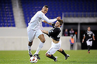 Tristan Watson (22) of the Cincinnati Bearcats gets past John Raley (6) of the Providence Friars. The Providence Friars defeated the Cincinnati Bearcats 2-1 during the semi-finals of the Big East Men's Soccer Championship at Red Bull Arena in Harrison, NJ, on November 12, 2010.