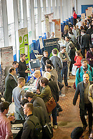 Visitors and job seekers crowd the TechDay New York event on Thursday, April 23, 2015. Thousands attended to seek jobs with the startups and to network with their peers. TechDay bills itself as the world's largest startup event with over 300 exhibitors. (© Richard B. Levine)