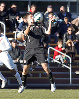 Brown University midfielder Bobby Belair (10) traps the ball. Brown University (black) defeated Boston College (white), 1-0, at Newton Campus Field, October 16, 2012.