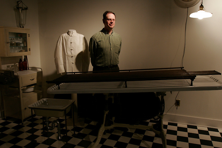 Museum of Funeral Customs executive director Jon N. Austin, shown in a re-created embalming room circa 1928.