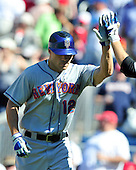 New York Mets right fielder Scott Hairston (12) is congratulated by a teammate after hitting his second home run in the ninth inning to tie the game against the Washington Nationals at Nationals Park in Washington, D.C. on Sunday, July 31, 2011.  The Nationals won the game 3 - 2..Credit: Ron Sachs / CNP.(RESTRICTION: NO New York or New Jersey Newspapers or newspapers within a 75 mile radius of New York City)