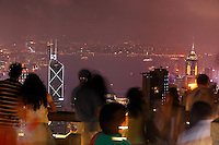 Tourists taking in view of downtown Hong Kong from Victoria Peak at night, Hong Kong SAR, People's Repbulic of China, Asia