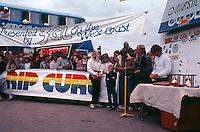 Bells Beach, Torquay, Victoria, Australia. The presentation of the Rip Curl Bells Beach Easter Classic 1981 with  Pam Burridge (AUS), Rod Brooks (AUS), Quiksilver founder John Law (AUS) and Surfing Australia's Alan Atkins (AUS). Judge Al Hunt (AUS) is in the window of the bus..Photo: joliphotos