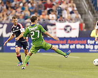 New England Revolution defender Flo Lechner (2) pass eludes a Seattle Sounders FC defender. In a Major League Soccer (MLS) match, the New England Revolution tied the Seattle Sounders FC, 2-2, at Gillette Stadium on June 30, 2012.